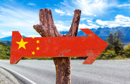 China flag sign with arrow on road background