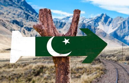 Pakistan flag sign with arrow on road background Stock Photo