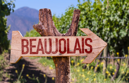 Wooden sign board in park with text: Beaujolais