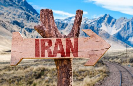 Iran sign with arrow on road background