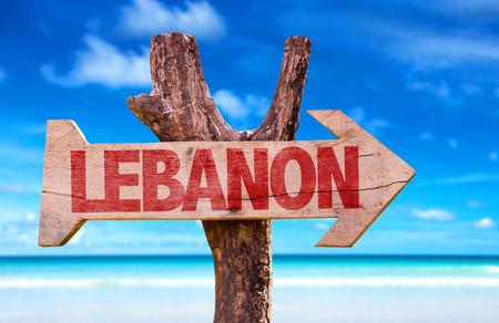 lebanon beach: Lebanon sign with arrow on beach background Stock Photo