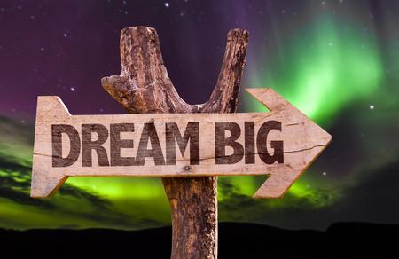 big sign: Dream big sign with arrow on aurora borealis background Stock Photo