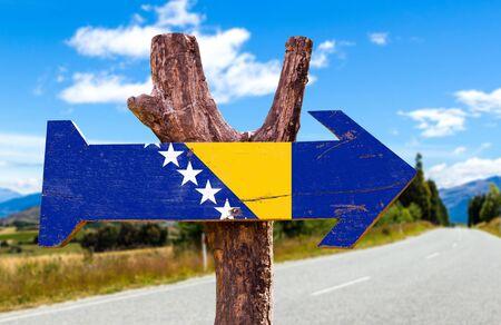 herzegovina: Bosnia and Herzegovina flag sign with arrow on road background
