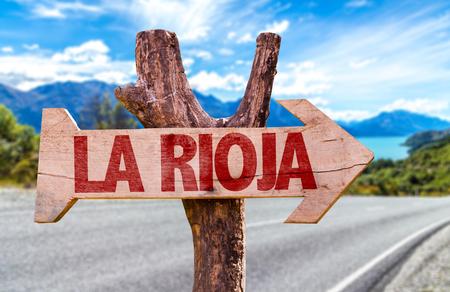 rioja: La Rioja sign with arrow on road background Stock Photo