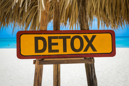 detoxing: Wooden sign board in beach with text: Detox