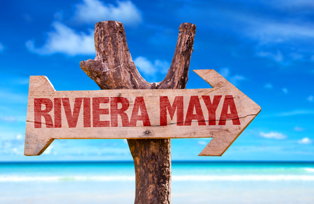 riviera: Riviera Maya sign with arrow on beach background
