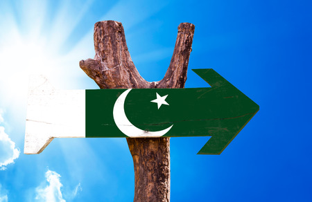 pakistan flag: Pakistan flag sign with arrow on sunny background