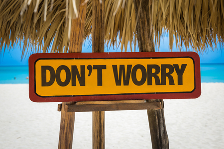 dont worry: Wooden sign board in beach with text: Dont worry