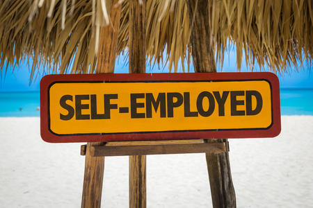 selfemployed: Wooden sign board in beach with text: Self-employed Stock Photo