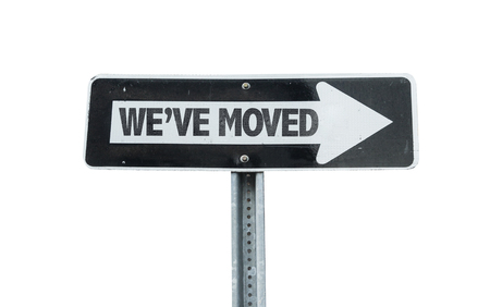 We've moved sign with arrow on white background