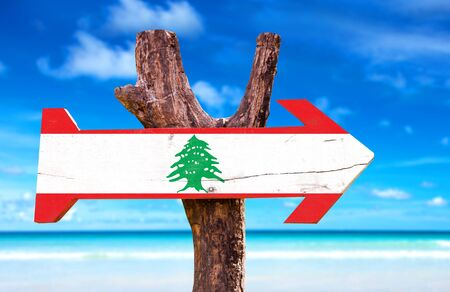 lebanon beach: Lebanon flag sign with arrow on beach background