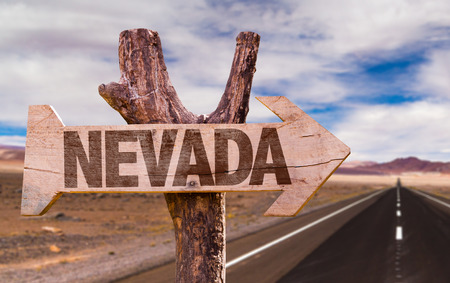 Nevada sign with arrow on road background