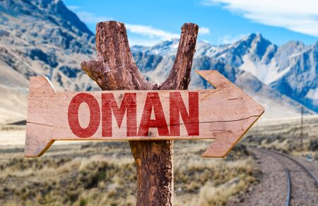 oman background: Oman sign with arrow on road background