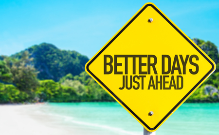 better days: Better days just ahead sign with beach background