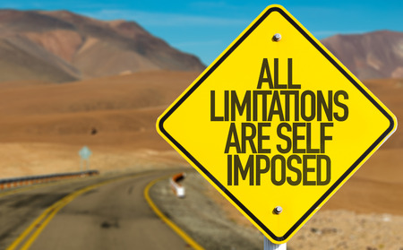imposed: All limitations are self imposed sign on a highway background Stock Photo