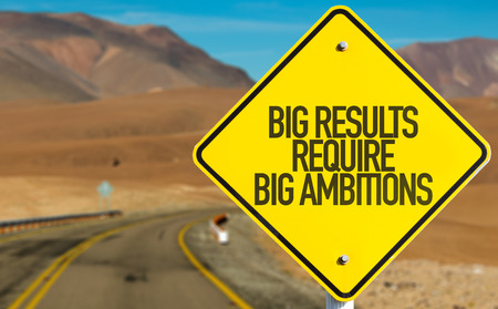 require: Big results require big ambitions sign on a highway background