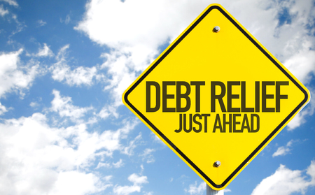 Debt relief just ahead sign with clouds and sky background Stock Photo