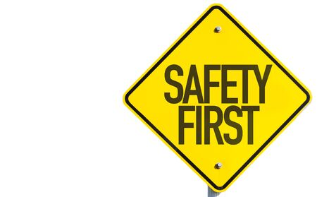 Safety first sign on white background