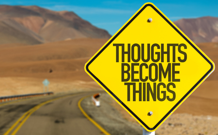 Thoughts become things sign on a highway background