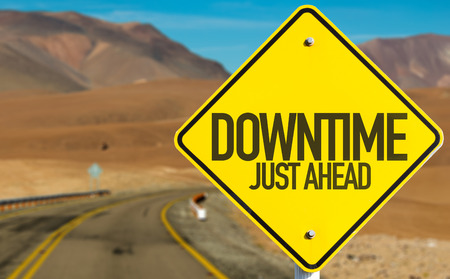 downtime: Downtime just ahead sign on a highway background