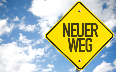 new way: Neuer weg (new way in German) sign with clouds and sky background