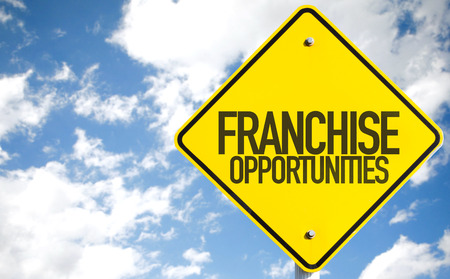 Franchise opportunities sign with clouds and sky background Stock Photo