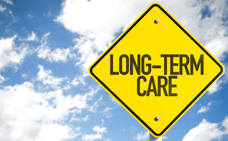 pflegeversicherung: Long-term care sign with clouds and sky background
