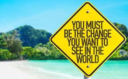 You must be the change you want to see in the world sign with beach background