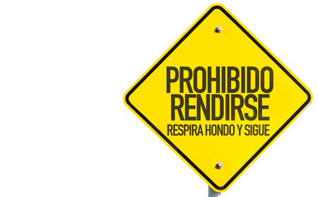 Prohibido rendirse respira hondo y sigue (don't surrender, take a deep breath and keep going in Spanish) sign on white background