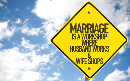 humoristic: Marriage is a workshop where husband works & wife shops sign with clouds and sky background
