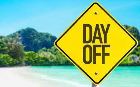 off day: Day off sign with beach background Stock Photo