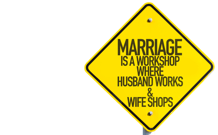 humoristic: Marriage is a workshop where husband works & wife shops sign on white background Stock Photo