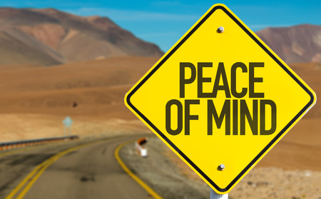 Peace of mind sign on a highway background