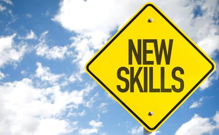 learning new skills: New skills sign with clouds and sky background
