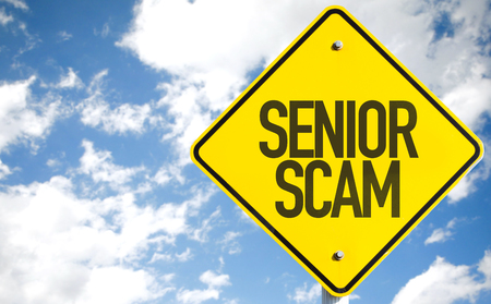 scamming: Senior scam sign with clouds and sky background