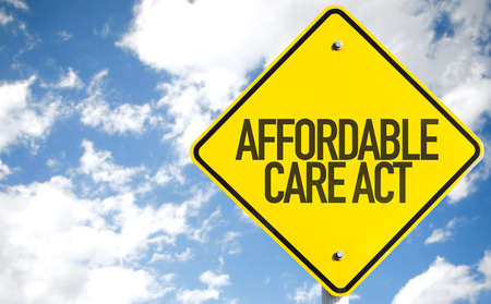 affordable: Affordable care act sign with clouds and sky background