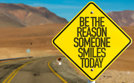 highway love: Be the reason someone smiles today sign on a highway background Stock Photo