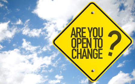 Are you open to change? sign with clouds and sky background