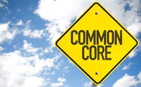 common goals: Common core sign with clouds and sky background