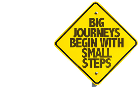 Big journeys begin with small steps sign on white background