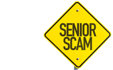 scamming: Senior scam sign on white background Stock Photo