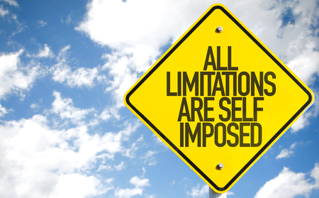 imposed: All limitations are self imposed sign with clouds and sky background Stock Photo