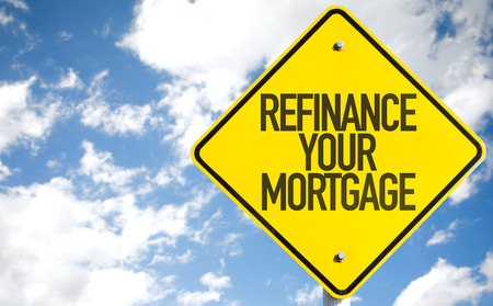 Refinance your mortgage sign with clouds and sky background