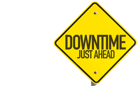 downtime: Downtime just ahead sign on white background Stock Photo