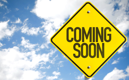 forthcoming: Coming soon sign with clouds and sky background