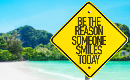 positiveness: Be the reason someone smiles today sign with beach background