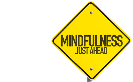 Mindfulness just ahead sign on white background