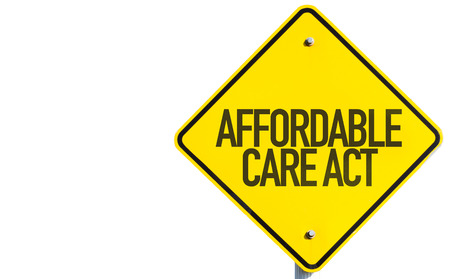 affordable: Affordable care of act sign on white background