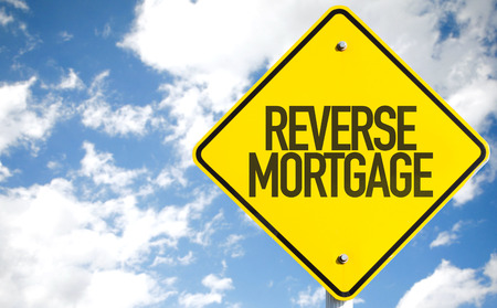 reverse: Reverse mortgage sign with clouds and sky background