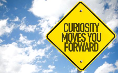 Curiosity moves you forward sign with clouds and sky background